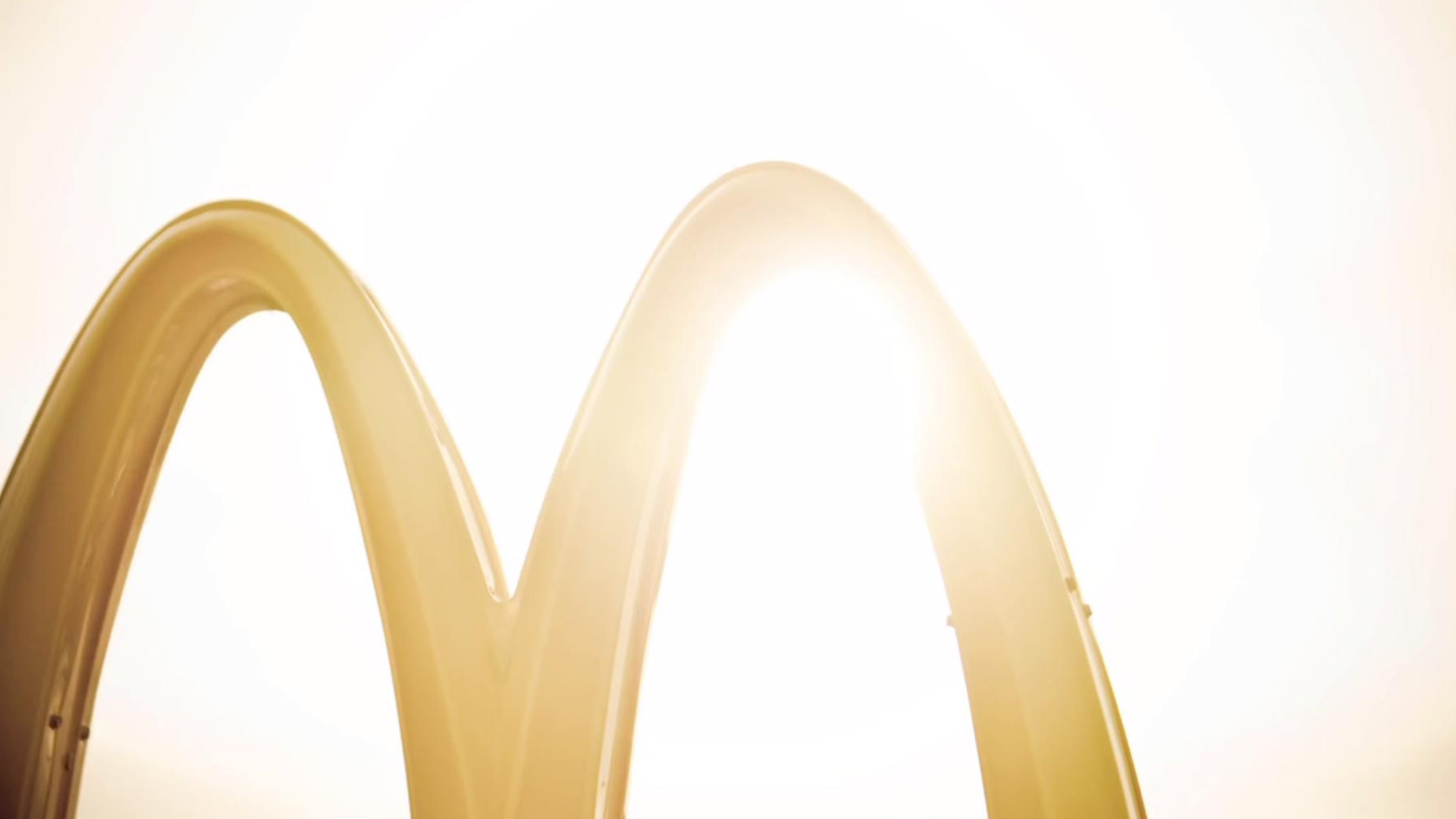 An image of the golden arches of a McDonald's sign.